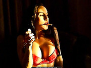 Stunner works out of her red bra while staying dedicated to her lit ciggy.