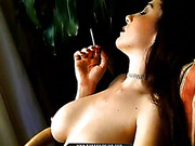 Sunlight spreads across the hot form of a sexy smoker who uses her fingers to pussy rub.