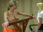 Helpless naked cutie is screaming during the whipping