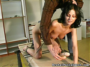Hogtied and suspended brunette beauty gets caned and her love holes teased