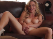 Blonde's green bra hits the ground, making her completely naked during masturbation.