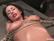 Hogtied brunette in tattoos gets suspended and banged badly in bdsm basement