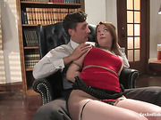 Brunette doll in red top gets bound with belts and gagged before rough anal sex