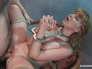 Long-haired blondie with natural tits gets caned before rough fuck in bondage