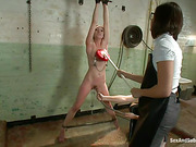 Curly girl gets bound with belts and fucked roughly by doctor and his female assistant with strap-on
