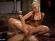 Blonde mistress in golden dress punishing her bearded gagged slave on the floor