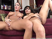 Girl duo undresses each other and folds tits and finger-fucks on red couch