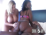 Blonde hottie in purple lingerie lets a lusty ebony suck her boobs before they let a black dude lick and fuck their pussies on a white bed.