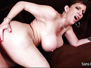 Naked cougar lets her handsome hubby suck her gigantic boobs before she lets him fuck her in different styles on a brown couch til he cums in her mouth.