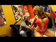 Smoking hot chick teases a handsome black guy as she dances on a pole wearing her lusty red lingerie while a smoking hot chick in black underwear watches before they get naked and sucks the spunk out of the black guy's dick.