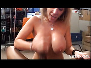 Erotic babe goes down naked and sucks a large dick before she squeezes it between her monster boobs then lets it blow jizz in her mouth.