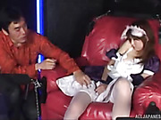 Asian cutie lays on a red couch and lets her master ravish her wearing her purple and white maid's uniform before she bends over and shows him her ass.