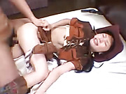 Gorgeous Asian chick in hot brown cowgirl costume lays down on a white bed and bares her big boobs while she gets fucked in missionary and spooning styles before she sucks the spunk out of his cock.