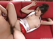 Lusty hottie teases a handsome dude as she lays down on a red couch and shows her sweet tits while she lets him fuck her in missionary style til her blows his load on her chest wearing her red and white anime costume.