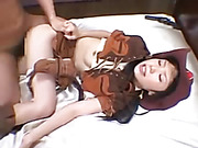 Smoking hot Asian chick shows her big boobs while she gets fucked on a white bed wearing her brown cowboy costume til she gets her mouth filled with hot cum.