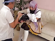 Purple haired Japanese chick pose her sexy body in different positions on a white couch wearing her white and brown anime outfit while having her picture taken on a white couch.