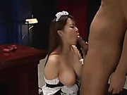 Sweet Asian maid in black and white uniform seduces her hunk boss as she shows him her big tits then licks her hunk body before she gets on her knees and sucks his dick then lets him bang her in missionary style on a green bed.