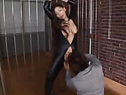 Smoking hot Japanese burglar with stunning curves in black leather outfit gets her hands tied on jail bars while she lets a handsome detective suck her big boobs.