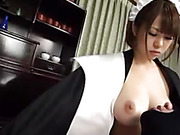 Smoking hot Asian maid lets a masked dude suck her huge breasts before she squeezes his big cock between them wearing her black and white uniform.