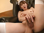 Luscious Asian maid seduces her master as she pose her banging body in white hat, underwear and stockings before she takes off her bra and expose her lusty boobs then peel off her panty, spreads her legs on a green couch and lets a horny stud finger her b
