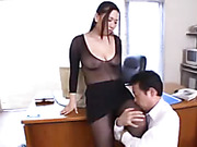 Lovely Asian babe displays her banging body on a brown couch wearing her sexy office attire before she strips off her blue coat and pink shirt then lets her horny boss suck her big tits wearing her black nylon outfit and skirt.