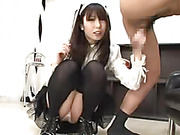 Asian chick in black and white maid's costume licks her master's asshole before she grabs his dick then jacks it in different positions.