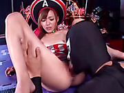 Stunning Asian babe spreads her legs wide on a purple mat and expose her small tits and nasty pussy wearing her blue, red and white cosplay outfit before she sits on a masked dudes face and make him eat her twat.