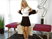 Long haired blonde cutie gets a massage and a mean pecker extra