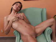 skinny brunette with perky tits plays with a glass dildo