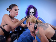 Tattooed blonde with dog collar obeys a horny bitch whatever she says and fuck by a man wearing a scary mask.
