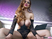 Long haired tattooed porn star showing off with pleasure