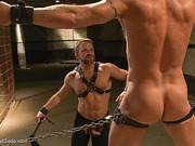 Male slave is chained in a cage and can't wait to escape