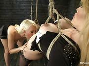 Gorgeous tranny engages in suspension bondage with an equally hot blonde bombshell.