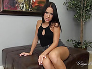 petite dark haired beauty in black swimsuit plays with her pussy