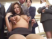 During a meeting with a lot of guys at an office, two Asian babes get put on a chair and groped by the guys