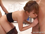 Lovely girl is enjoying a threesome on the office and giving a double blowjob