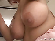 Adorable Japanese office girl with big tits looks really great