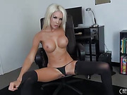 sexy little milf with blonde hair and big fake tits masturbates