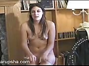 foxy brunette beauty teases and plays with her fat pussy
