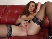 brunette babe wearing a black lingerie shows off her sweet pink slit
