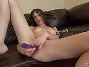 exotic beauty with gray eyes fucks her pussy with super long dildo