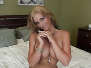 mature slut with big tits fucks her pussy with a huge toy
