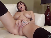 gorgeous brunette chick in black high socks shows her wet pussy