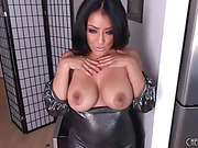raven haired beauty gropes her tits while playing with her pussy