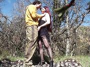 Redhead slut in stockings gets rammed hard outdoors