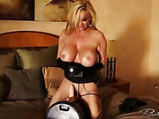 Horny slut in black lingerie goes nude and fucks robot sex toy
