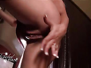 Horny slut with amazing ass and big tits plays with black dildo