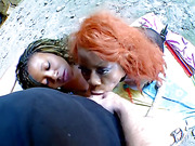 Two big-booty ebony babes in tights fuck huge dildo and double-team guy at beach