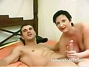 Busty black-head MILF in pink-shirt and leather-skirt gets ass-fingered and fucked by young cock