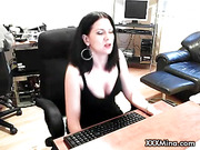 Beauiful cam babe in black dress dildos her pussy using glass dildo.